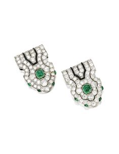 Pair of Platinum, Emerald, Diamond and Onyx Clips, Mauboussin, France, Circa 1930 Set with two square emerald-cut emeralds, within openwork surrounds set with eight buff-top emeralds, onyx plaques and numerous old European-cut diamonds weighing approximately 4.30 carats, each signed Mauboussin France.