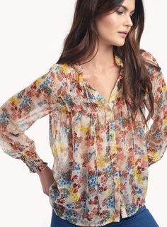 3bd7a0634b1be An exquisite silk floral blouse with a fine ruffle accent at collar