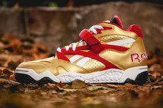 The Reebok Pump Paydirt Mid is set to drop in a new San Francisco colorway. This flashy offering features a metallic gold leather upper with red midfoot supports and strap Urban Fashion, Mens Fashion, White Reebok, San Francisco 49ers, Clothes Horse, Gold Leather, Hypebeast, Footwear, Pumps