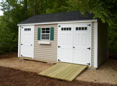 Beautiful Back yard Storage. Double doors for easy mower access. This is a Cape Ann Style Shed with wicker siding, green shutters, and dual black roof shingles. Customize the colors to match your home!
