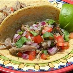 Pork shoulder is braised until very tender, then finished in the oven to produce a delicious filling for tortillas.