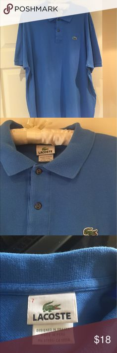 Lacoste men's blue polo Authentic Lacoste polo shirt in a lovely blue cotton. Size large and slight signs of wear. Lacoste Tops Tees - Short Sleeve