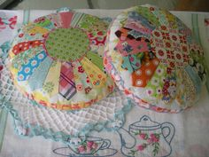 Sweet Scrappy Dresden Plate Pincushion Pillow, via Etsy. Oh, I love the dresden plate pattern. The scrappy look of this is so adorable.