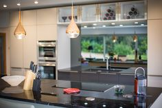 Above, three copper pendant lights further enhance the ambience.