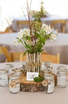 Rustic Wedding Ideas: We love this rustic centerpiece! Photographed by Matt and Jentry: Photographers (via Rustic Wedding Chic)