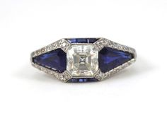 Asscher Cut Diamond and Sapphire Art Deco Ring   From a unique collection of vintage three-stone rings at https://www.1stdibs.com/jewelry/rings/three-stone-rings/