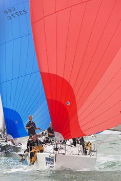 The J/109 yacht 'Shadowfax' with spinnaker racing in the Solent during Cowes Week 2013