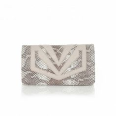 Bracher Emden Snake Lucy Clutch Bold, applique enhances this unique structured clutch. Once the strong magnetic fastening is lifted soft Cream Lamb's Leather enriches the inside. A chain style cross body strap with leather detailing for comfort helps position this individual piece as the perfect accessory to take you from daytime to evening wear. Cotton lining interior with inside zip pocket. Materials Lamb Leather / Water Snake Dimensions Price $544.15