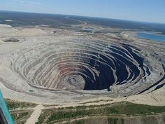 Udachnaya Diamond Mine, Russia Like the Sarlacc Pit on Steroids, the Udachnaya Mine in Russia is a gigantic open-pit diamond mine that plunges more than 600 metres into the earth's crust. Yep, it's one heck of a hole. Located in Russia's vast but sparsely populated Sakha Republic, just outside the Arctic circle, it seems that mining for these precious stones demands a good set of thermal undies