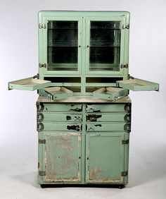 c.1930 ART DECO METAL DENTAL CABINET, glass front doors,  all drawers swing out ..