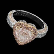 18k gold Michael Beaudry engagement ring features a 2.42ct heart-shaped fancy pink center diamond.