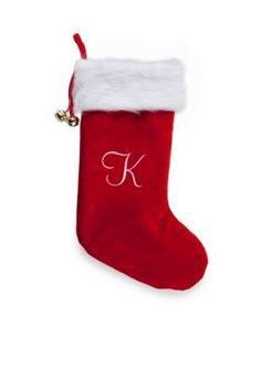 This Christmas stocking features a monogrammed letter in a traditional holiday color scheme for a customized touch.