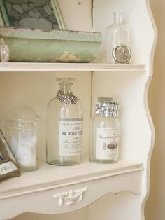 Don't keep your beautiful bracelets hidden away in a jewelry box: display them in your bathroom on bottles. Use vintage glass containers like this HGTV fan did in her bathroom, or recycle a beautiful bottle from your pantry.
