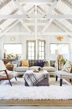 farmhouse interior white living room with high beamed ceilings                                                                                                                                                     More