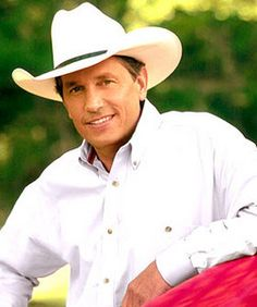 George Strait. The King of Country Music. He has always been one of my favorite singers and always will be. He has stayed true to what Country is supposed to be and he has stayed true to himself. He only plays music that comes from his heart and that's how I want to be. None of this rock and roll and pop stuff that we are tortured with nowadays.