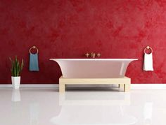 """Design tip: Highlight your tub by painting your walls """"Netflix red."""""""
