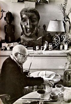 "Picasso painting ceramics at the dinner table. ""La Californie"" Cannes, France 1956Photographed by David Douglas Duncan."