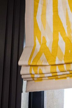 Detail of a yellow and white roman shade banding in the kitchen of the 2012 San Francisco Decorator Showcase.