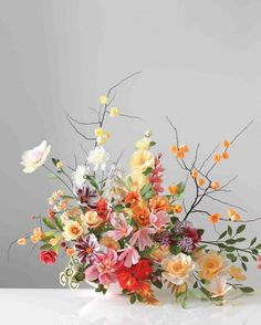 Wild Faux Flowers Centerpiece:  19 Ways to Decorate With Faux Flowers for Your Wedding and Save *BIG* Time via Brit + Co