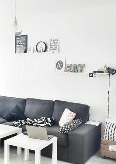 ikea grey sofa and white tables