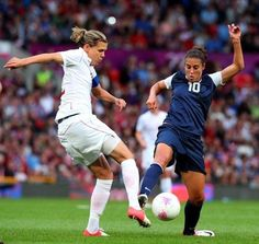 Christine Sinclair of Canada tackles Carli Lloyd of the United States during the Women's Football Semi Final match between Canada and USA, on Day 10 of the London 2012 Olympic Games at Old Trafford on August 2012 in Manchester, England. Fifa 2015, Carli Lloyd, World Cup Champions, Fifa Women's World Cup, Us Soccer, Old Trafford, Sports Pictures, Olympic Games, Schedule