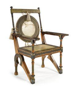 """Carlo Bugatti (1856-1940) - Arm Chair. Oak, Brass & Pewter Inlays, Ebonized Wood, Vellum and Silk Tassles. Circa 1900. 44-7/8"""" (114cm)."""