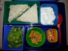 Kid Bento Lunch -banana and cream cheese sandwich (Udi's bread) -cottage cheese -kiwi -Annie's pretzels -chocolate covered sunflower seeds