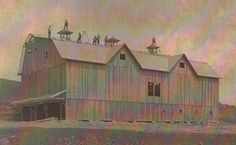 In this photograph from 1915, these men are working on a barn roof. They were hired for $1 a day, but the foreman was paid $5 each day, an exceptional wage at the time. All of the lumber for the barn was sawed from wood on the farm. See more vintage farm photos on our website.