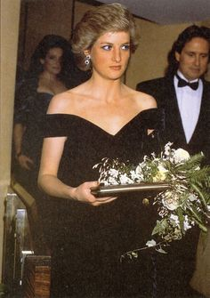 Princess Diana with Michael Douglas in background.
