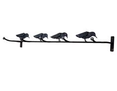 A heavier version of the couple's tin folk-art find, these hooks support a flock of iron crows. ($59; atwestend.com)   - CountryLiving.com
