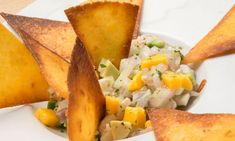 Receta de Ceviche de lubina, gambas, aguacate y mango