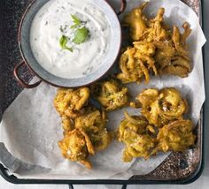 Red onion & chilli bhajis with mint & garlic raita recipe - Recipes - BBC Good Food
