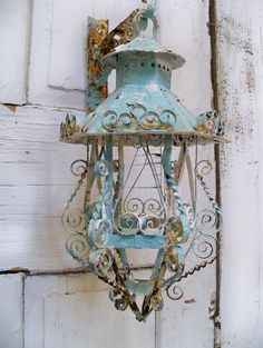 Rusted aqua lantern...this would be a nice little Christmas accent..use a little greenery and red