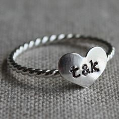 """true love.This wonderful ring starts with twisted sterling wire that is paired with a sweet domed heart (10x8mm) that is stamped with you and your love's initials. A beautiful reminder of the true love in your life! Entirely sterling silver and handmade from start to finish!  You can have initials separated by an ampersand, three initials (5 if you choose the fancy font) or simply leave the heart blank. For the lowercase typewriter font, please be aware that the lowercase """"L"""" can look like…"""