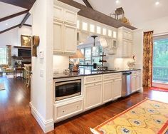 Kitchen inspiration - white cabinetry, wood floors and stainless steel appliances