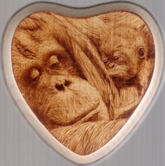 "Wood burning by Colleen Jess, 2012, Orangutans, 7"" heart, greatjesspectations@gmail.com"