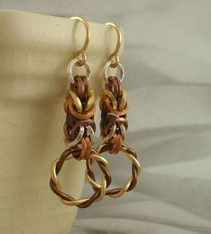 Mmmmm...these earrings are rich as chocolate and just as delicious! Glowing copper and bronze linked with shining gold and silver in gorgeous Byzantine weave with beautiful twisted loops to round them off (pardon the pun!) You'll want to make sure your hair is pulled back to show these off and you'll be the talk of the town! Best of all...did you see the price? >> TY!