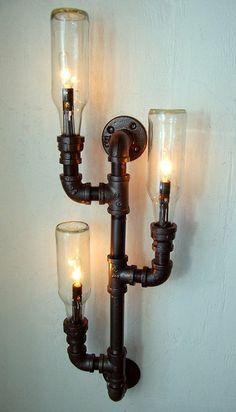 Industrial Wall Sconce, plumbing pipe repurposed Uses 12oz bottles but wondering if wine bottles of half bottles will work...
