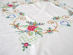 embroidered vintage tablecloth vintage white tablecloth floral tablecloth shabby chic cross stitch tablecloth via Etsy