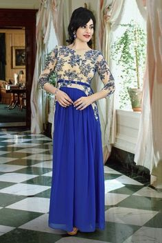 Royal Blue Colour Georgette Fabric Party Wear Gown Comes with matching blouse. This Gown Is crafted with Lace Work This Gown Comes As a Semi stitched Which Can Be Stitched Up to Size 42....
