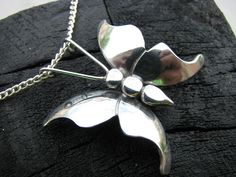 Steel Butterfly Pendant by Mrballeng.  Needed: A small square of 22 gage sheet metal. I bought a 22 gage sheet at the hardware store for about $8.00. Wood nail Paper clip
