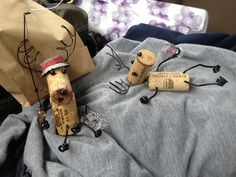 Cut Christmas Wine Cork Reindeer ornamennts, can put one on painted popsicle stick skis