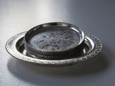 vintage silver plated coasters set of 6 round coasters marked Sweden on back coasters have an ornate chased design on base stackable Coaster Set, Vintage Silver, Sweden, Silver Plate, Rings For Men, Base, Unique Jewelry, Handmade Gifts, How To Make