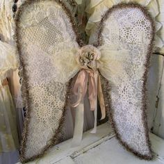 Fabric and wire angel wings wall hanging romantic vintage laces w/ aged tinsel and millinery flowers shabby cottage chic anita spero design