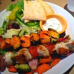 Zoes Kitchen Salmon Kabob hummus & greek salad plate for lunch at zoe's kitchen. #vegetarian
