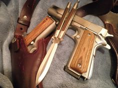 Beautiful wood grip 1911s and matching Balisong (Butterfly Knife)