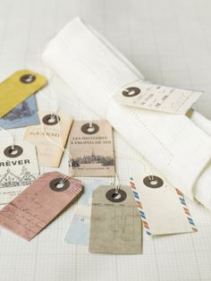 idea: luggage tags, staple seed packets, attach to large key ring