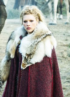 Noblewoman wearing a thick dyed wool cloak and wolfskin.