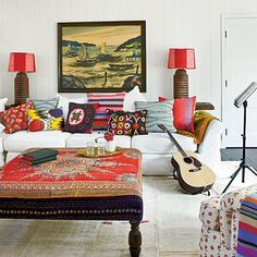 Kathryn Ireland ties most of her fabrics together with a shared color: red, which is seen on several fabrics, the ottoman, lamp shades, and even in the painting. | Coastalliving.com
