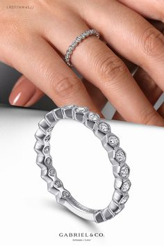 This magnificent stackable ring boasts 0.43cts of bezel set round for unforgettable sparkle. The 14k white gold band flaunts a contoured silhouette masterfully detailed with refined milgrain edges. Breathe new life into your look with this stylish stackable ring. LR51174W45JJ #LadiesRing#FashionLadiesRing#GoldRing #GoldFashionRing#GiftIdeas #WhiteGoldRing#WhiteGoldFashionRing #Rings#FashionRings#UniqueRings #Stackable#DiamondStackable#StackableRings #FineJewelry#FashionJewelry#UniqueJewelry Diamond Bands, Gold Bands, Stackable Rings, Gold Fashion, White Gold Rings, Breathe, Fine Jewelry, Sparkle, Silhouette